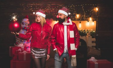 Winter holidays and people concept. Christmas man suit fashion. Couple in love. Drunk Girls celebrate New Year. Christmas home interior. Christmas bomb. Creative boom.