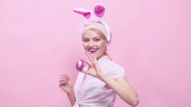 Sexy beautiful pin up girl with blond hair with bunny ears. Woman in bunny ears. Funny Easter bunny woman. Lovely charming pin up girl in bunny ears celebrating Easter. Egg hunt.