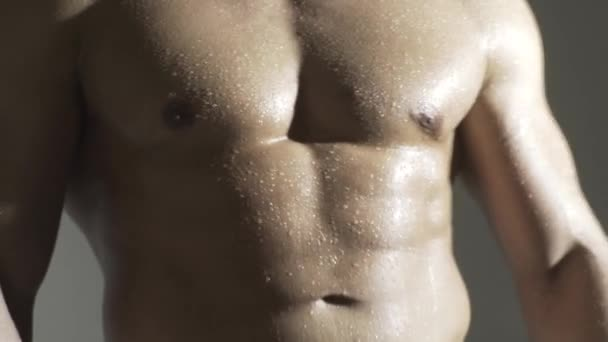 Man with sexy shoulders, abdomen, abs or six pack.