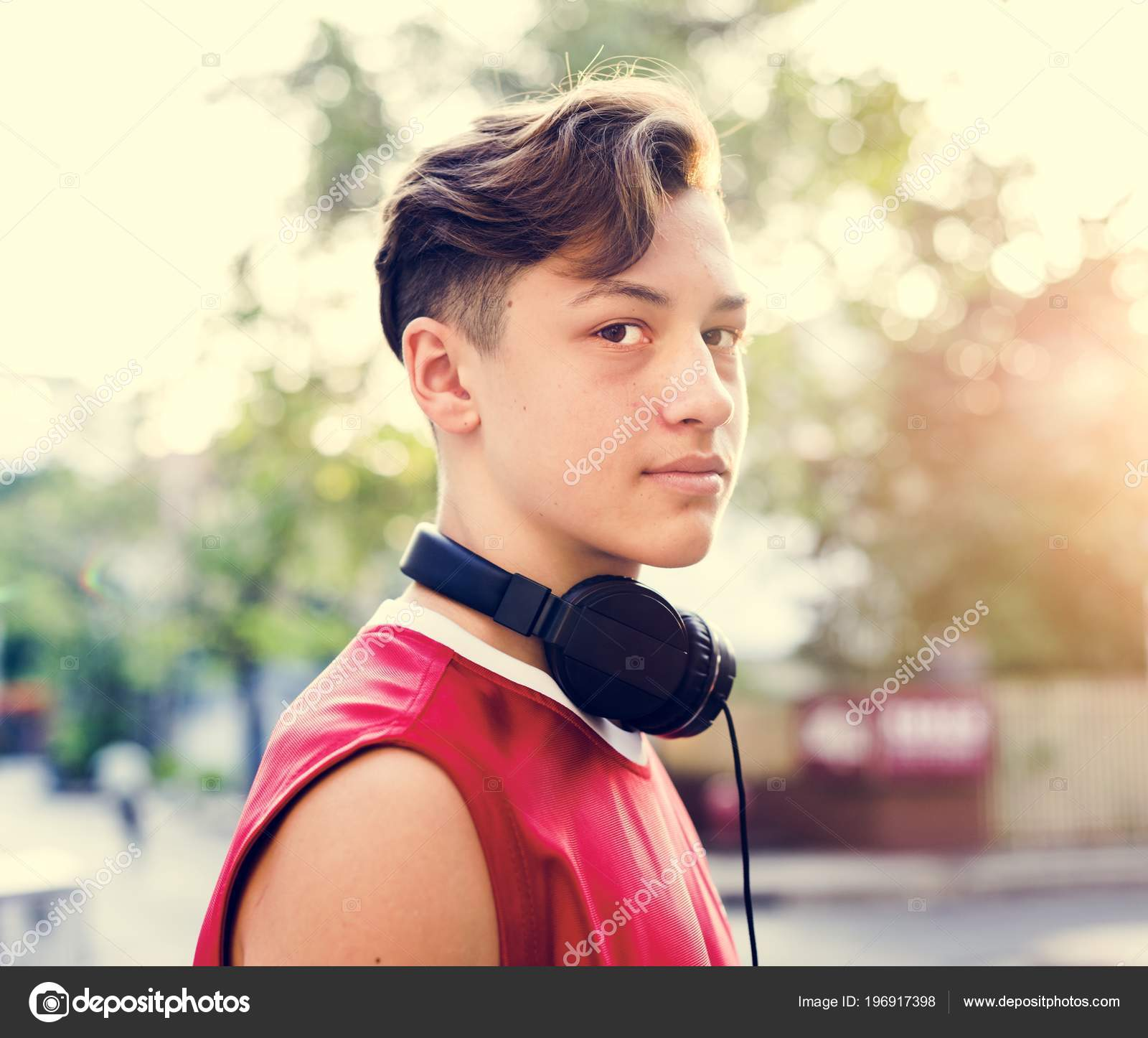 sporty teenage boy outdoors looking camera portrait \u2014 stock photo