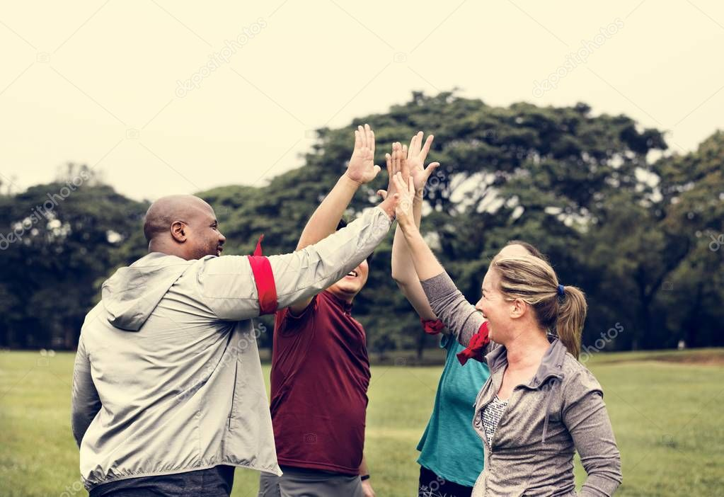 Diverse people making a high five
