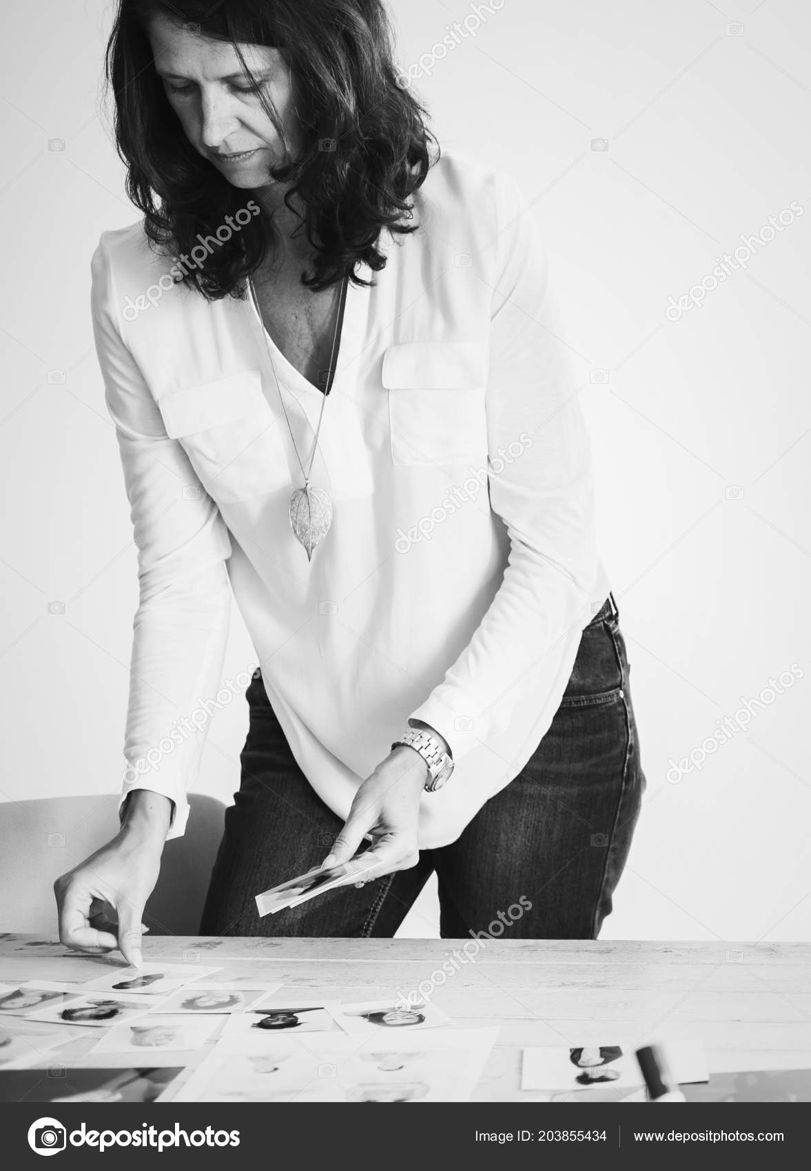 Black and white shot of adult professional magazine editor selecting models photos photo by rawpixel