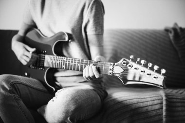 Woman playing an electric guitar