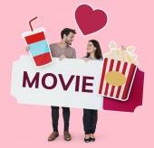 Fotografie Happy couple holding movie icons