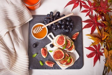 Sandwich with cream cheese, figs and honey. Healthy food concept. Autumn harvest.
