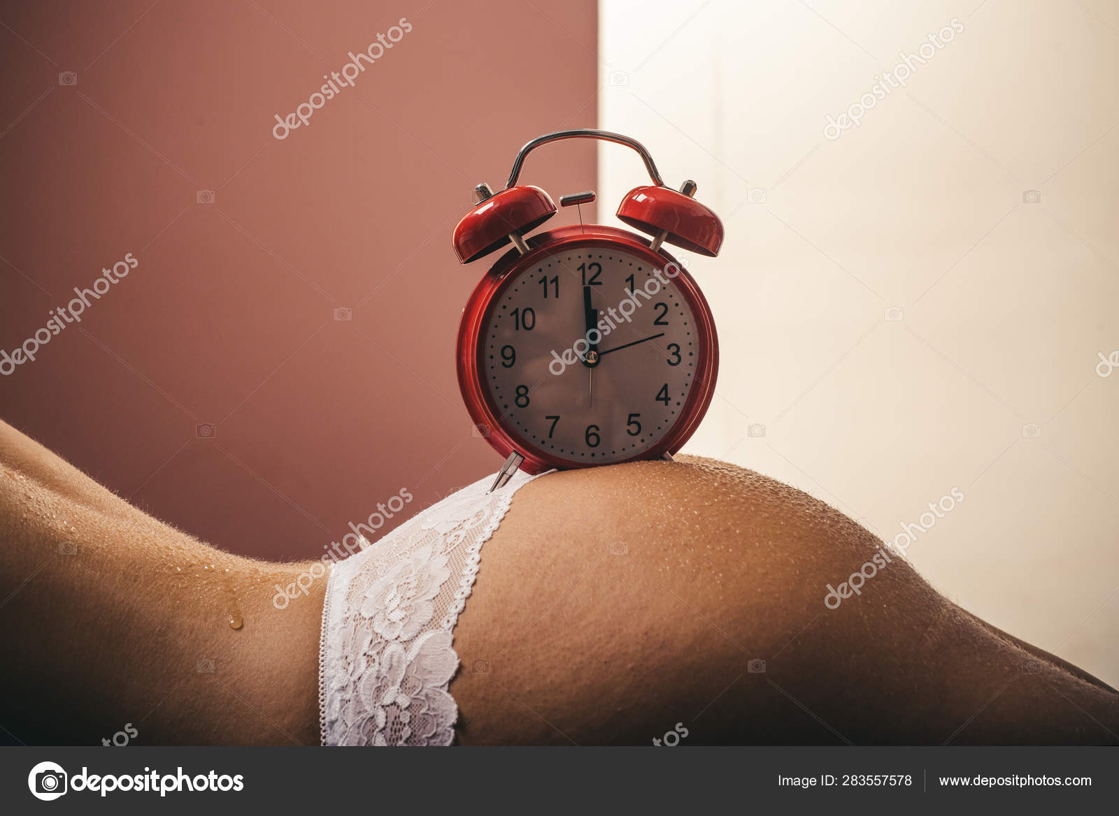 Wake up  Morning alarm clock on the naked female ass  Time