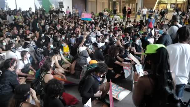 Miami Downtown, FL, USA - JUNE 12, 2020: BLM. Protest Black Lives Matter footage. Protesters are sitting on the street in Miami.