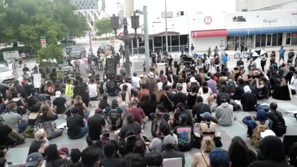 Miami Downtown, FL, USA - JUNE 12, 2020: Protesters took to the streets in cities across the U.S. after a white police officer was charged with the murder of an unarmed black man.