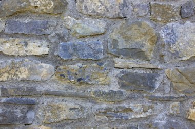 Texture of a natural big stone wall. Old castle stone wall texture background.