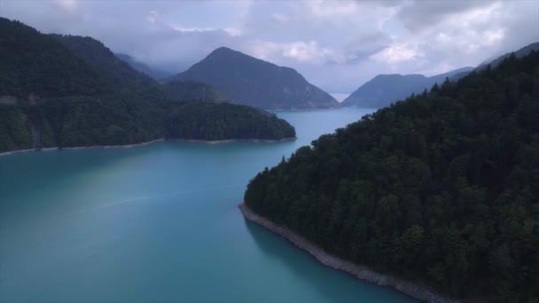 Aerial flythrough of beautiful lake and mountains. Inguri in Georgia