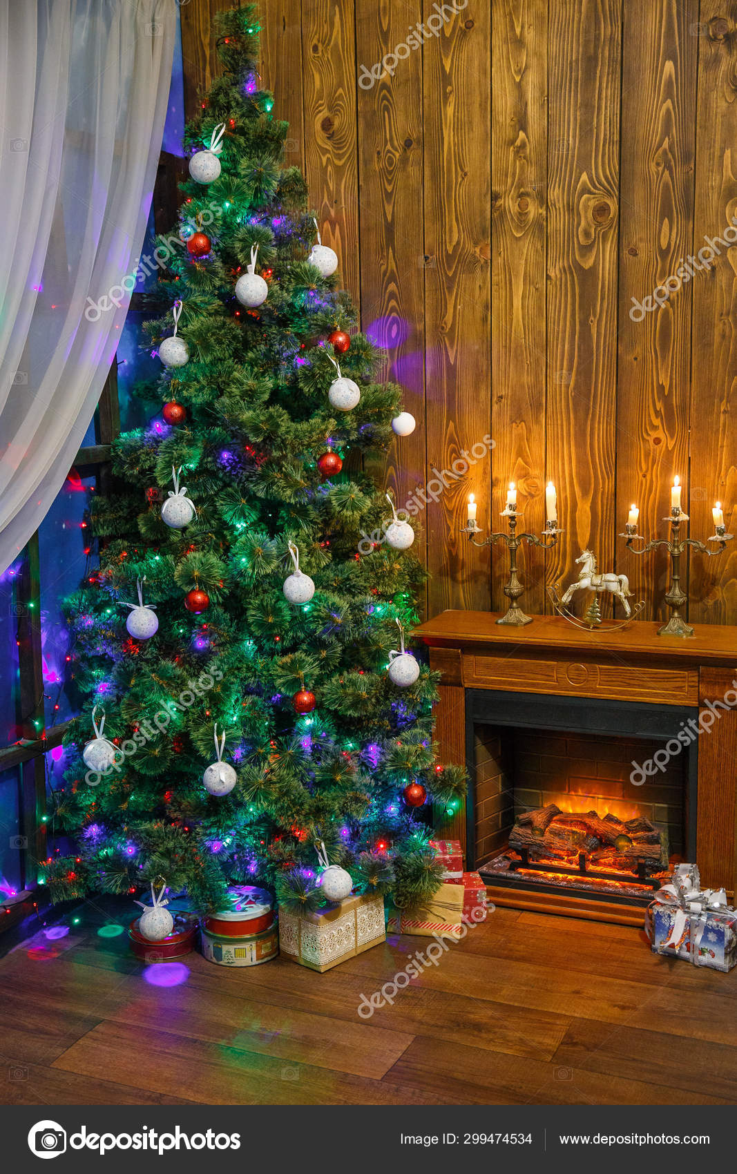 Christmas Interior With Toys And Lots Of Candles Wooden Fake Fireplace Christmas Tree Boxes In Studio Stock Photo C Petrenkoalyona 299474534
