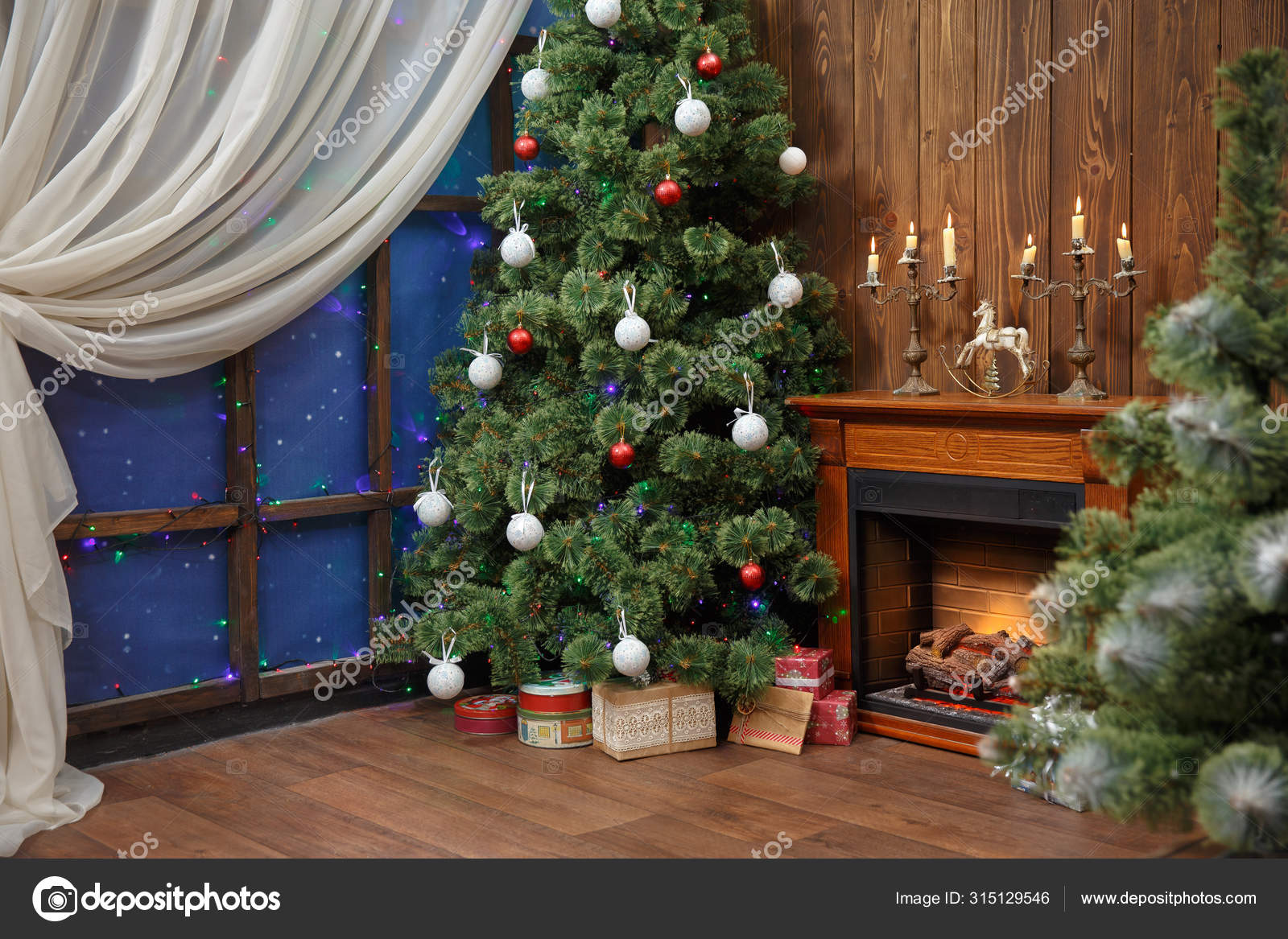 Christmas Interior With Toys And Lots Of Candles Wooden Fake Fireplace Christmas Tree Boxes In Studio Stock Photo C Petrenkoalyona 315129546