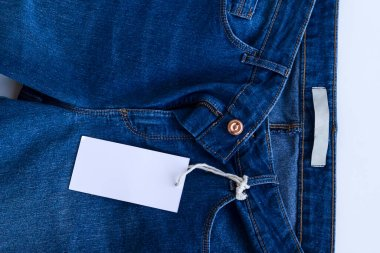 New,unused blue jean background with blank label