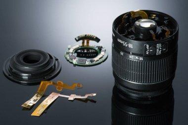 Optics details. Broken digital SLR camera lens on grey background stock vector