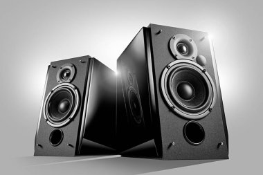Black glossy music speakers on light grey background. Hero view shot. Audio technics. Reflection in the piano lacquer surface
