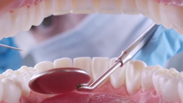 Dentist inspects patients teeth with probe and mirror