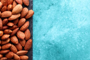 Almonds on a beautiful abstract background. Nuts. View from above.