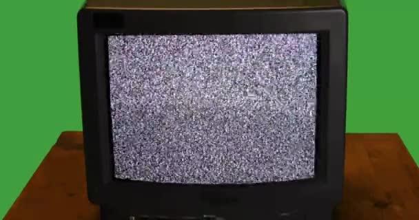 Retro TV-vel, hó zaj a képernyőn a fából készült asztallap audio