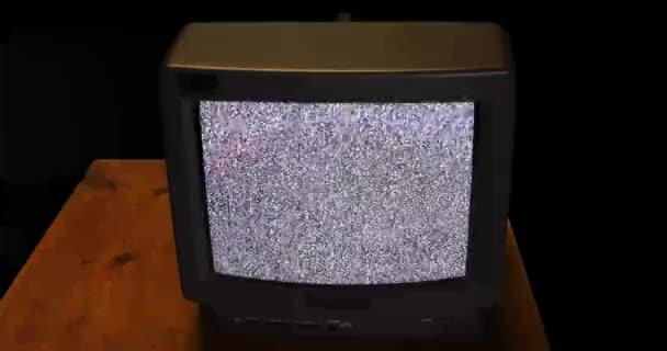 Kézzel, lüktetett a retro TV-vel, hó zaj a képernyőn a fából készült asztallap audio
