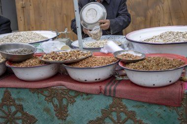 Vendor selling nuts and sweets in market in Old City  Kashgar, or Kashi, Xinjiang, China.