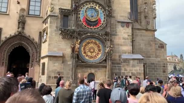 Prague, Czech Republic - May 19, 2019 :  Tourists watching the procession of the Apostles chiming the hour in the Astronomical Clock in the Old Town Clock Tower of Prague, Czech Republic.