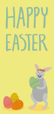 Happy Easter card. Cute grey bunny holding green decorated egg, laughing, wearing flower crown, standing. Pile of colorful eggs. Hand drawn lettering. Yellow background. Vertical DL size.