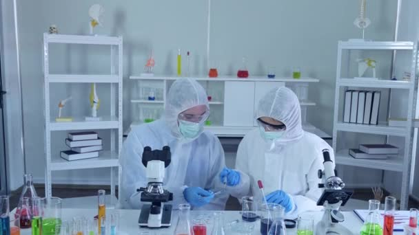 the scientists working in the laboratory