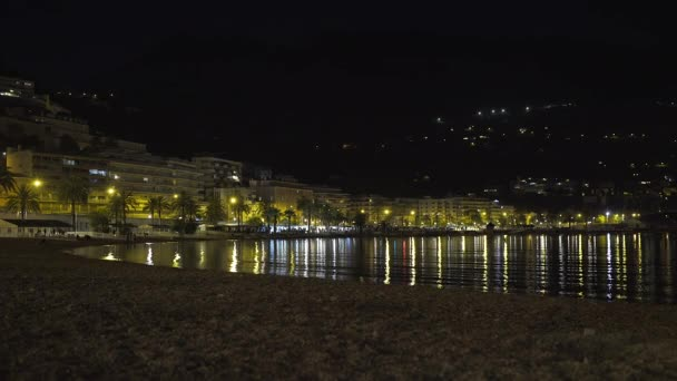 Menton, France - July 2, 2020: Night panoramic view of the illuminated beach and the town of Menton
