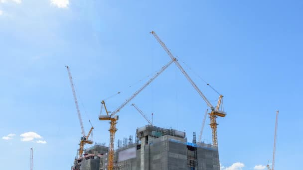 Time lapse of Crane on construction building in sunshine day