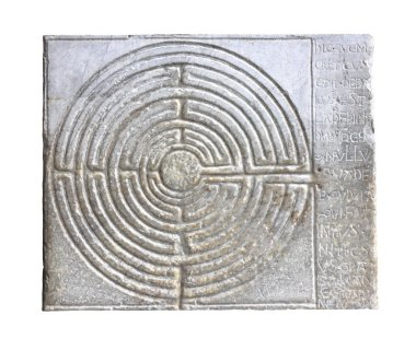 Medieval labyrinth carved on the facade of a Romanesque church o