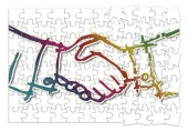 Handshake against a white background - concept image in jigsaw p