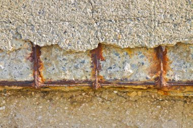 Reinforced concrete with damaged and rusty metallic reinforcemen