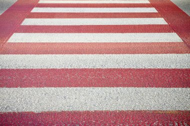 Red and white pedestrian crossing with copy space