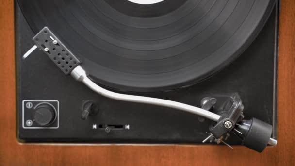 Old vintage gramophone playing vinyl record. Retro Vinyl Turntable. Top view