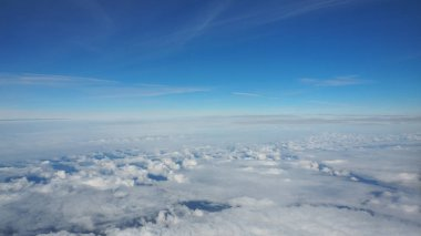 view of the clouds through window of an airplane.
