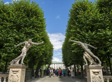 SALZBURG, AUSTRIA - JULY 25, 2017. Statues guarding the entrance of the Mirabell palace gardens in Salzburg, Austria