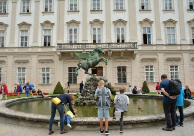 SALZBURG, AUSTRIA - JULY 25, 2017. Winged horse statue and Mirabell Palace and Gardens in Salzburg, Austria