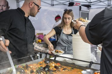 CONSTANTA, ROMANIA - MAY 20, 2017. People at Festival mussels 2017. Chefs cook mussels after a recipe of the famous Catalin Scarlatescu Chef ,on the streets of the Old city of Constanta in Romania.