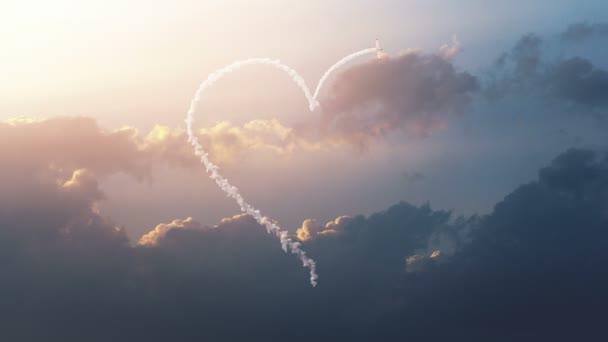 Letadlo kreslí tvar srdce na obloze