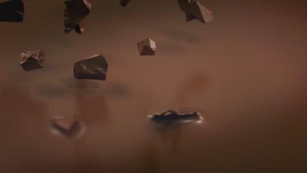 Kousky čokolády stříkající do tekuté mléčné čokolády v 4K Super zpomalený film