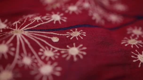Macro of dark red lacy fabric with circular patter.chinese floral pattern fabric