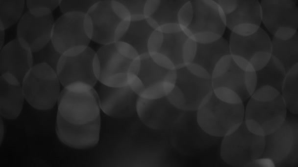 black and white blurred abstract bokeh black background for backdrop, twinkled bright bokeh defocused and sparkles background.