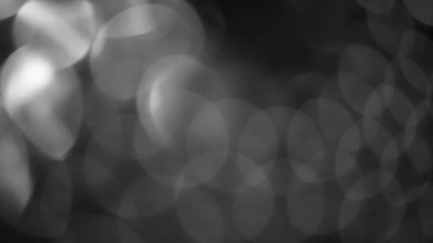 černá a bílá rozmazané abstraktní bokeh černé pozadí pro pozadí, blikající jasný bokeh rozostřené a jiskří pozadí.