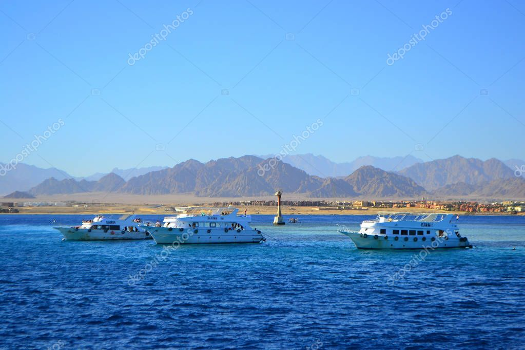 View at the sea shore with white yachts near tourist center and resort for summer vacation,Sharm El Sheikh, Egypt, January 6, 2019