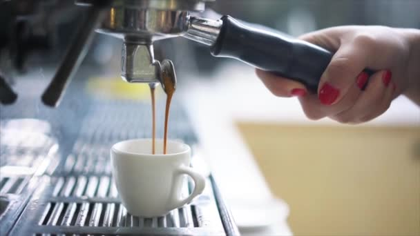 Professional espresso machine pouring fresh coffee