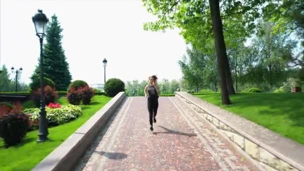 Athlete woman jogging in park. Sport woman at morning workout