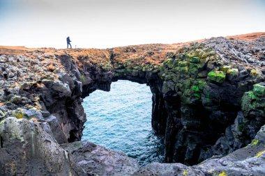 Stonebridge a volcanic stone arch at Arnarstapi, West Iceland