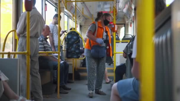 A friendly tram conductor taking care of passengers