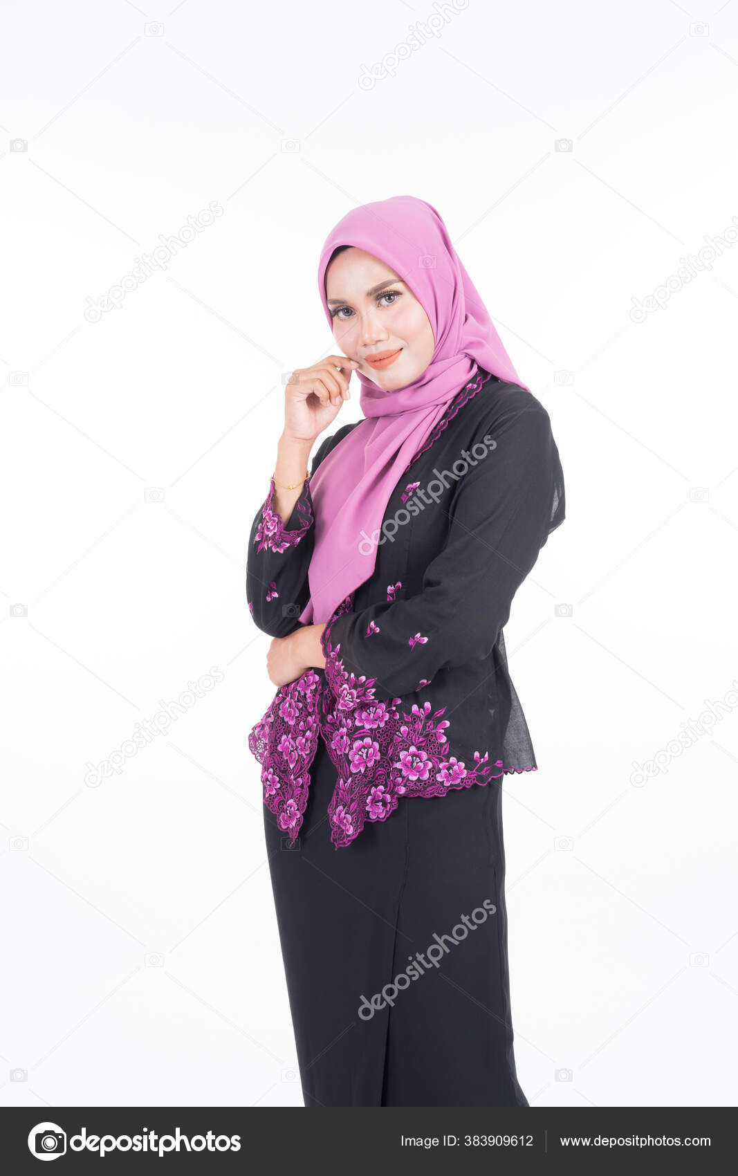 Beautiful female model in kebaya and hijab, a modern lifestyle apparel for  Muslim women isolated on white background. Beauty and hijab fashion