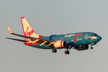 Melbourne, Australia - September 25, 2011: Virgin Blue Airlines 50th aircraft Boeing 737-7FE VH-VBY on approach to land at Melbourne International Airport.